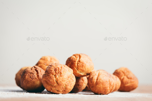 Bunch of baked donuts laying on the kitchen counter. - Stock Photo - Images