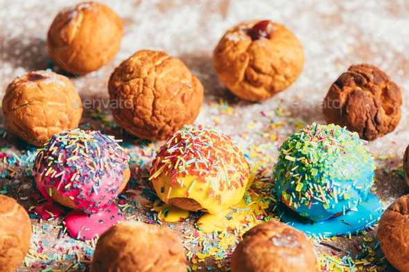 Doughnuts laying on a messy kitchen counter - Stock Photo - Images