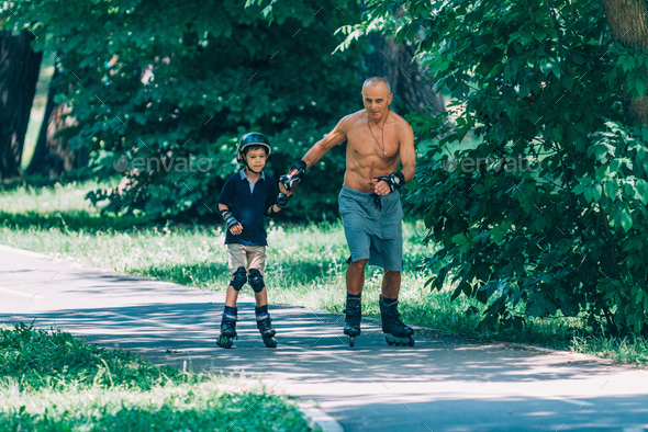 Roller skating in the park with grandfather - Stock Photo - Images