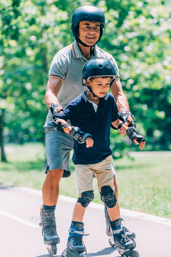 Grandson learning roller skating - Stock Photo - Images