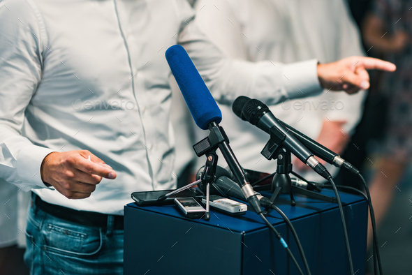 Businessman during press conference - Stock Photo - Images