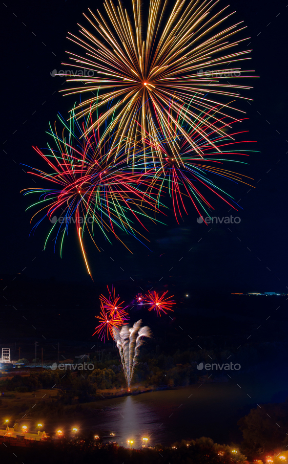 fireworks on the banks of river photographed from atop - Stock Photo - Images