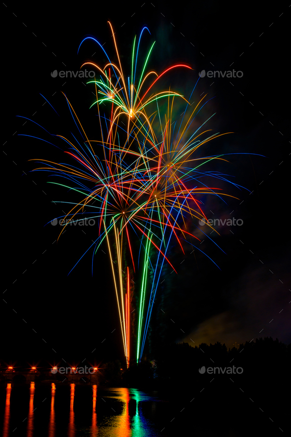 fireworks reflected in the river water - Stock Photo - Images