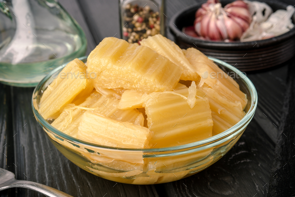 bowl with boiled cardoon, typically eaten in Spain on modern black board - Stock Photo - Images