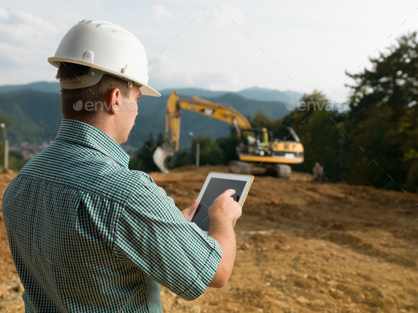 architect checking plan on tablet - Stock Photo - Images