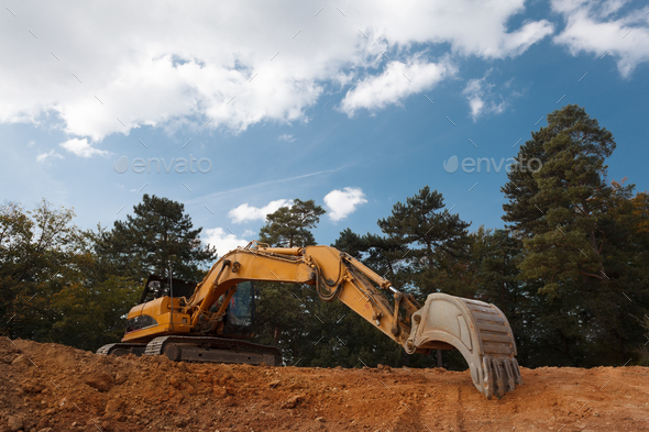 excavator digging on construction site - Stock Photo - Images