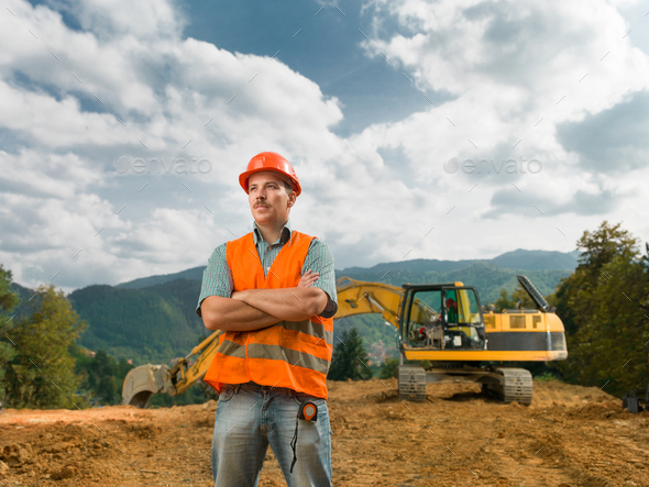 engineer standing on construction site - Stock Photo - Images