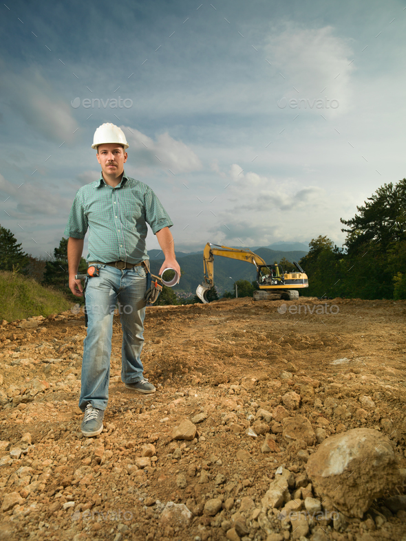 confident engineer on construction site - Stock Photo - Images