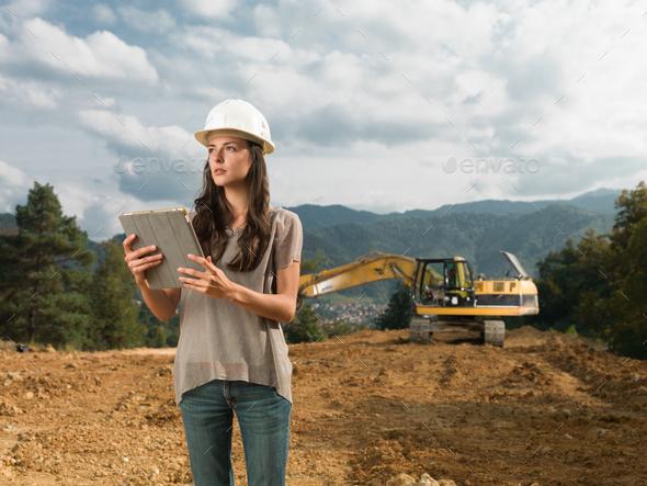 female architect supervising construction - Stock Photo - Images