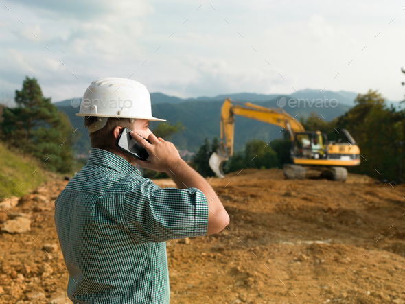 male engineer talking on the phone - Stock Photo - Images