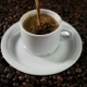 Coffee Cup and Coffee Beans. A White Cup of Evaporating Coffee on the Table with Roasted Bean - VideoHive Item for Sale