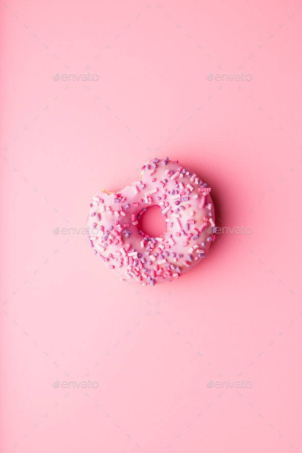 A bitten donut. - Stock Photo - Images