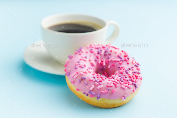 Pink donut and coffee cup. - Stock Photo - Images
