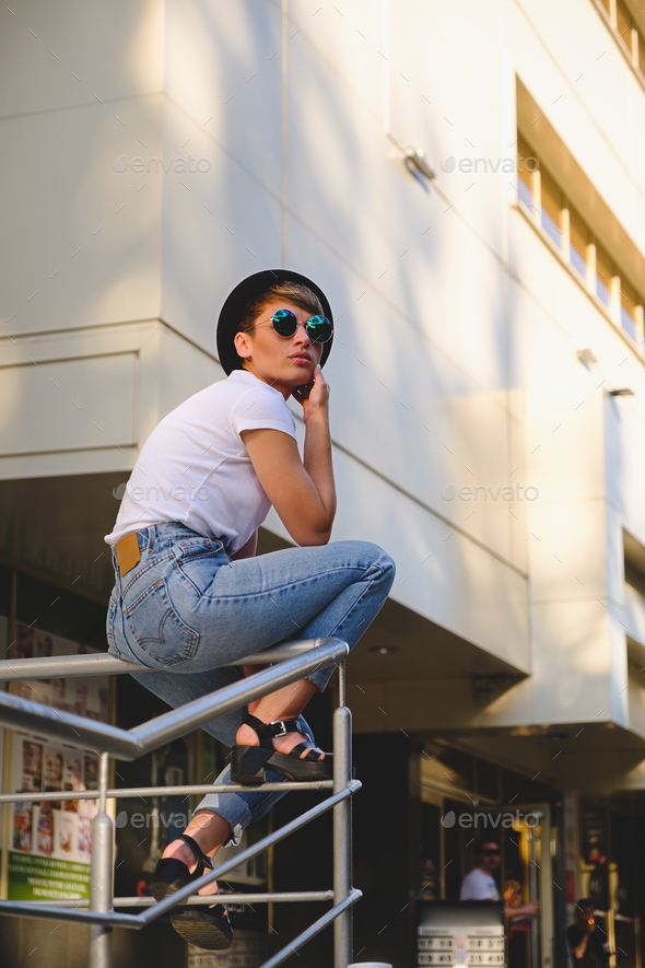 Modern woman portrait wearing stylish round glasses hanging out - Stock Photo - Images