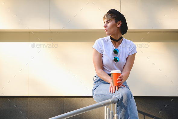 Hipster girl drinking coffee to go - Stock Photo - Images