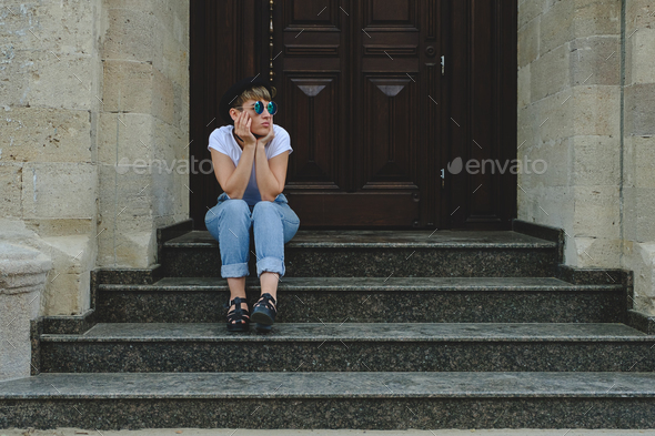 Beautiful young hipster woman posing sitting on stairs - Stock Photo - Images