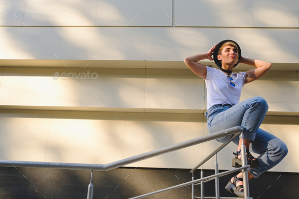 Young hipster woman relaxing - Stock Photo - Images