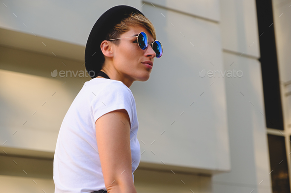 Woman wearing fashionable sunglasses - Stock Photo - Images