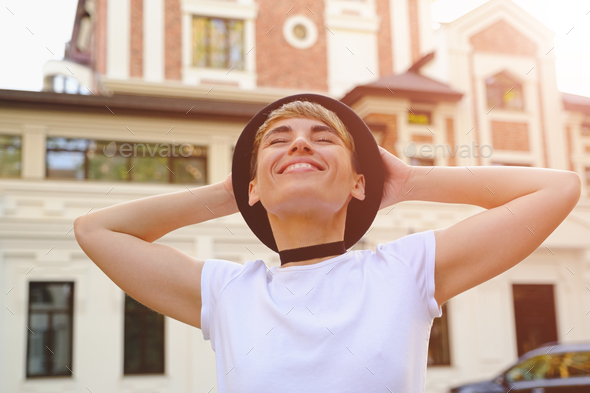 Woman enjoying a beautiful day in the city - Stock Photo - Images