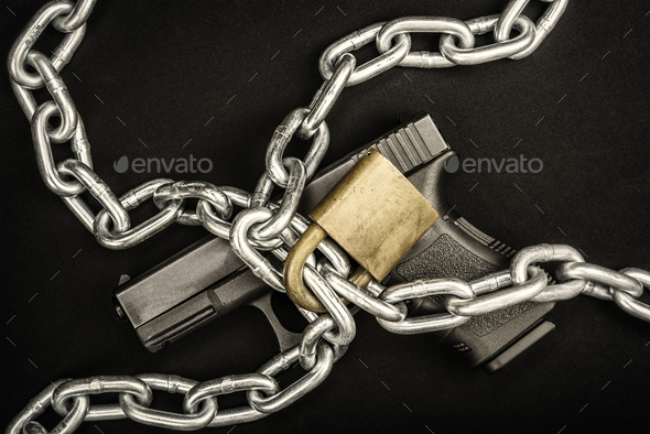 Chained up handgun - Stock Photo - Images
