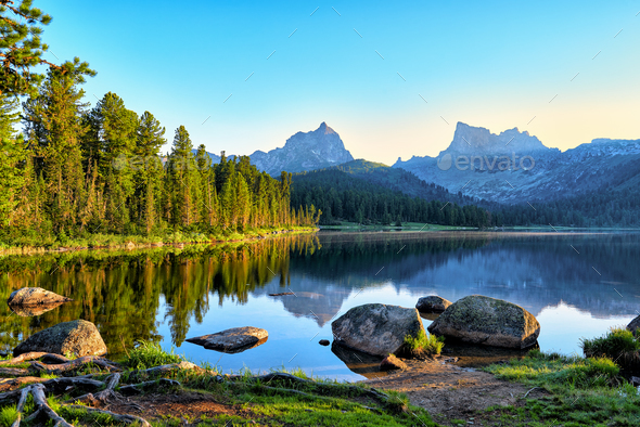 Early Summer Morning on Mountain Lake - Stock Photo - Images