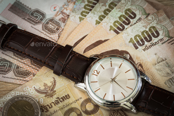 Watch and banknote - Stock Photo - Images