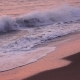 Gorgeous Waves Form Foam on the Sandy Beach in the Rays Sunset - VideoHive Item for Sale