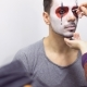 Make-up Artist Makes Greasepaint on Man's Face Before His Performance on Scene - VideoHive Item for Sale
