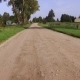 Dirt Road Passing along the Houses in the Country Side - VideoHive Item for Sale