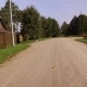 Dirt Road Passing through a Cottage Village - VideoHive Item for Sale