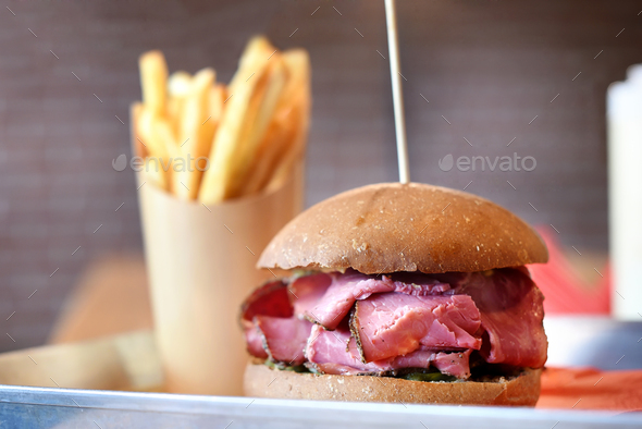 Pastrami sandwich served with potato chips - Stock Photo - Images