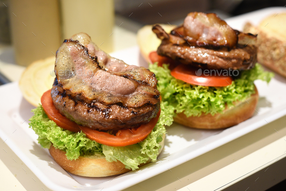Preparing a hamburger in a restaurant - Stock Photo - Images