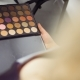Woman Holds Palette with Makeup Shadows - VideoHive Item for Sale
