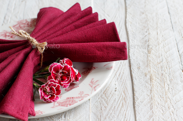 Table setting with carnation flowers - Stock Photo - Images