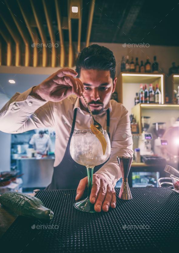 Bartender is stirring cocktails - Stock Photo - Images