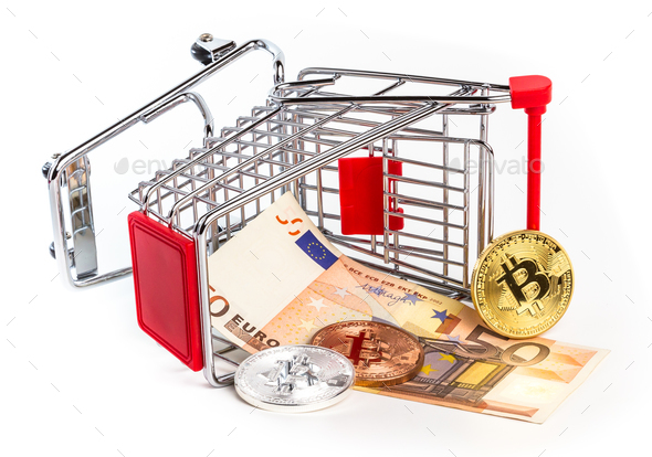 Bitcoins and fifty euro banknote in overturned shopping cart - Stock Photo - Images