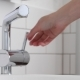 Female Hand Open Mixer with Water in Bathroom - VideoHive Item for Sale