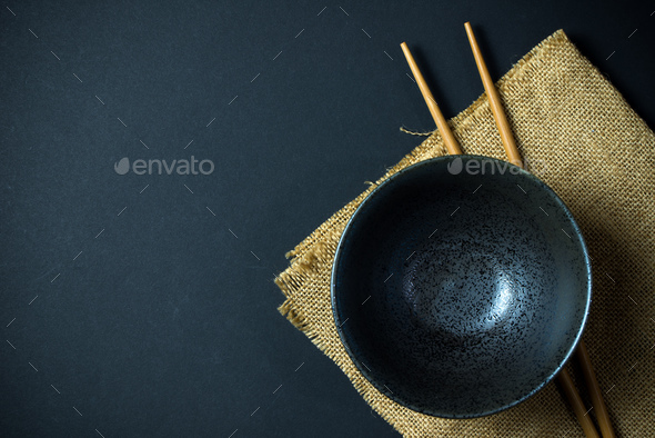 Empty bowl with chopsticks - Stock Photo - Images