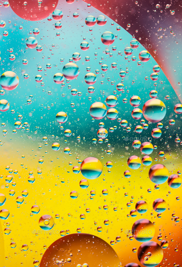 oil bubbles in water, rainbow colors - Stock Photo - Images