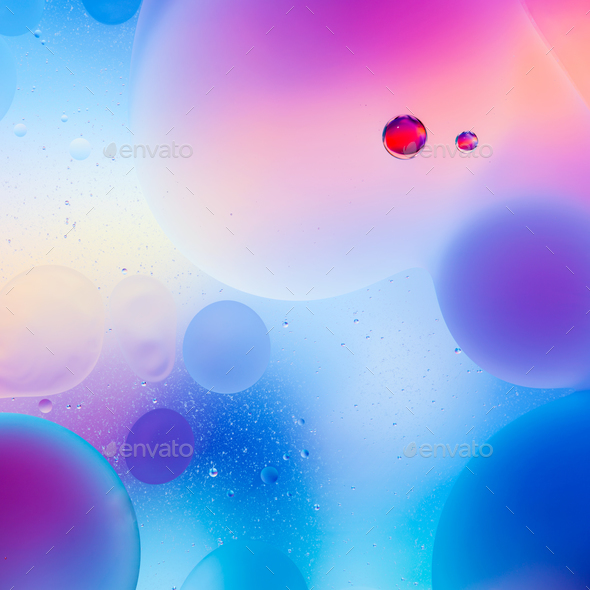 macro of colorful oil drops on water - Stock Photo - Images
