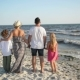 Portrait of Mother, Father, Son and Daughter Holding Hands on the Beach During Sunny Windy Day Near - VideoHive Item for Sale