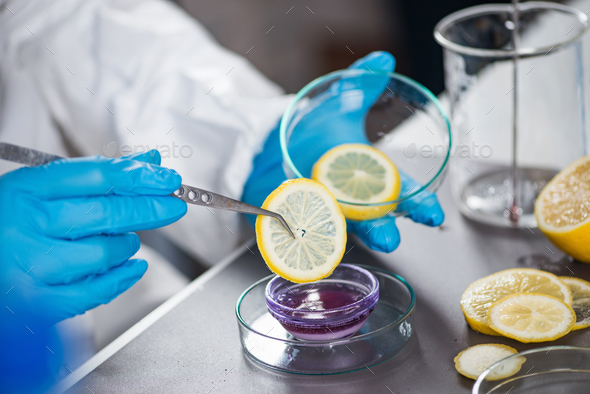 Food safety inspector testing fruit from the market - Stock Photo - Images