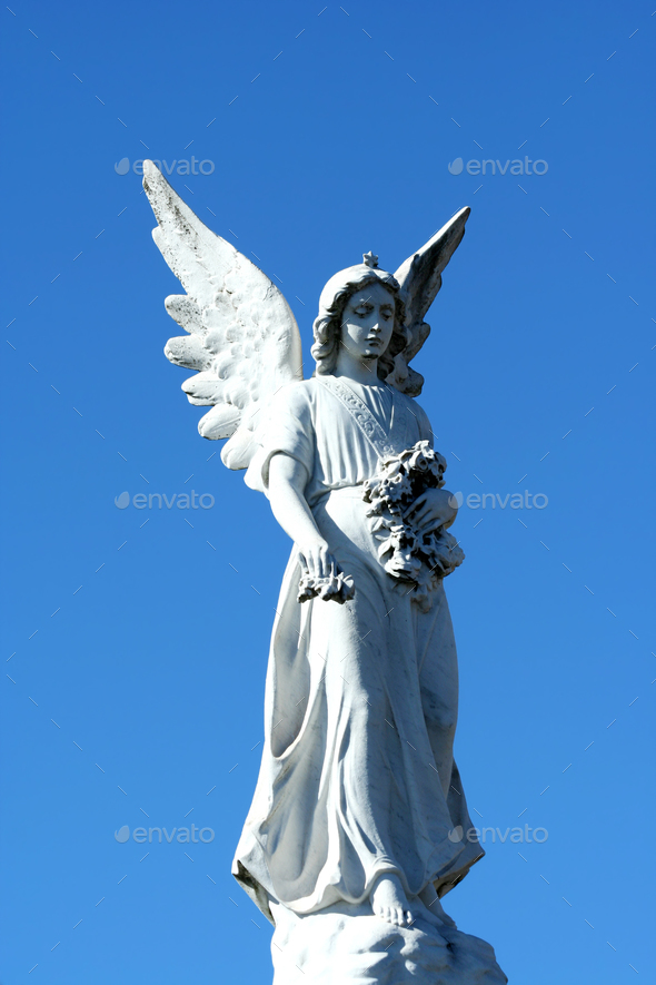 Angel statue with blue sky - Stock Photo - Images
