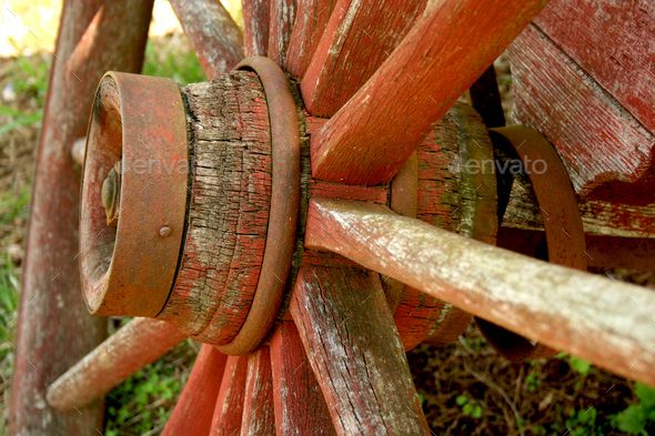 Old weathered red wagon wheel - Stock Photo - Images
