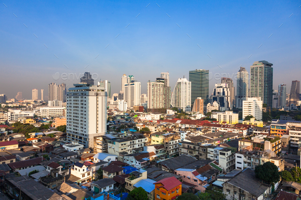 Contrast between new and holding buildings in Bangkok, Thailand - Stock Photo - Images