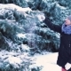 the Snow Slowly Falls From the Tree, the Girl Touches the Branch of the Tree and the Snow Falls on - VideoHive Item for Sale
