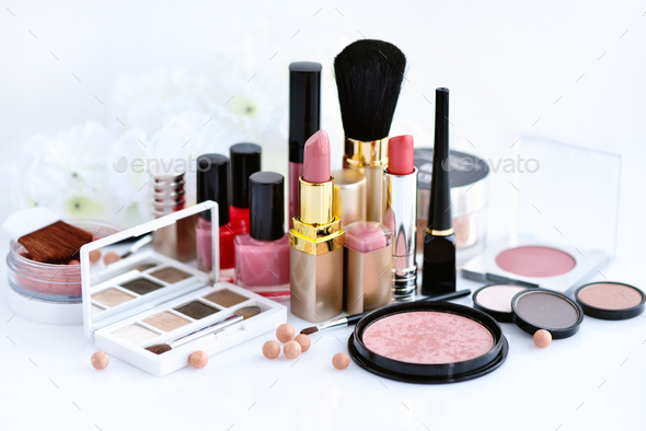 Set of decorative cosmetic: powder, lipsticks, brush, blush, eye - Stock Photo - Images