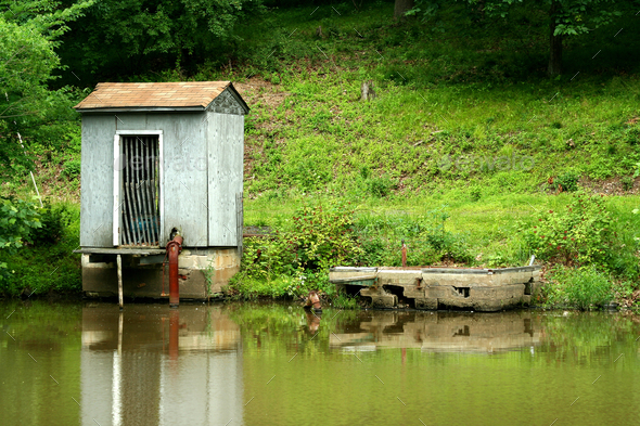 Pump house on a small pond - Stock Photo - Images