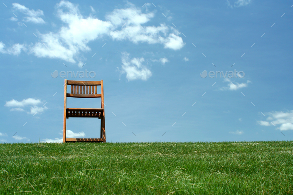 Wooden chair on a hilltop - Stock Photo - Images