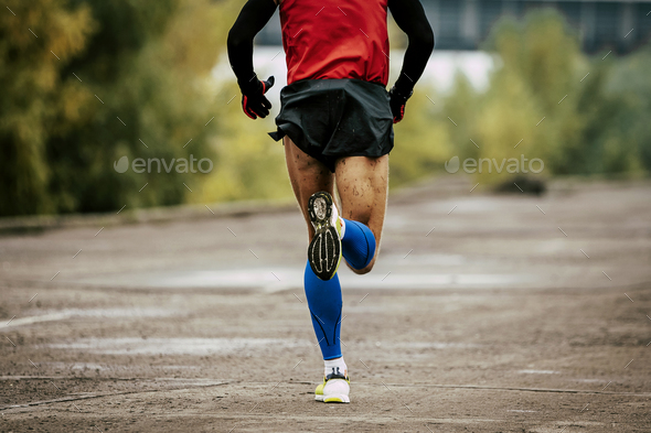 back man in compression calf sleeves - Stock Photo - Images